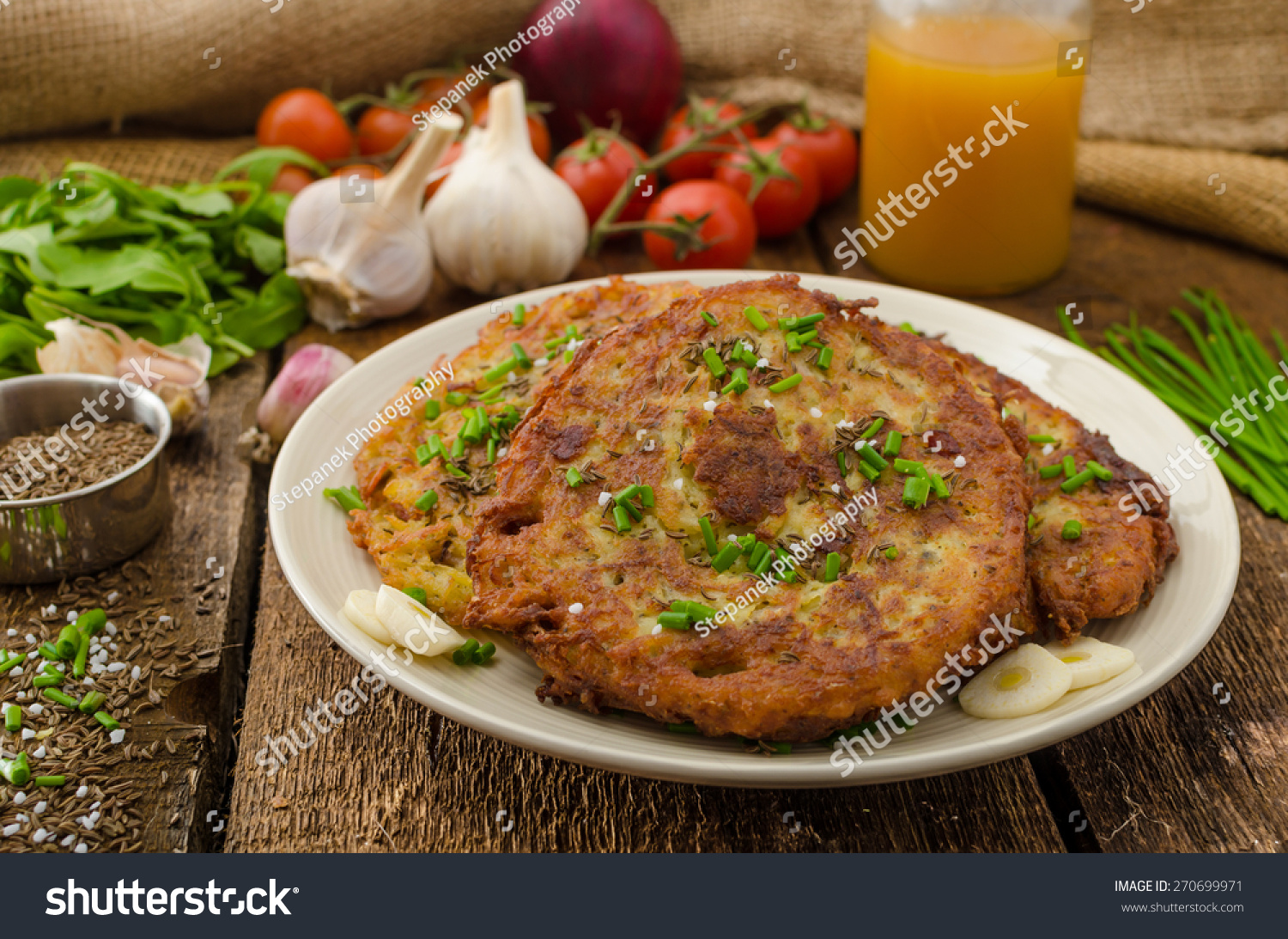 Fried potato pancakes with garlic and marjoram, sprinkled cumin, chive ...