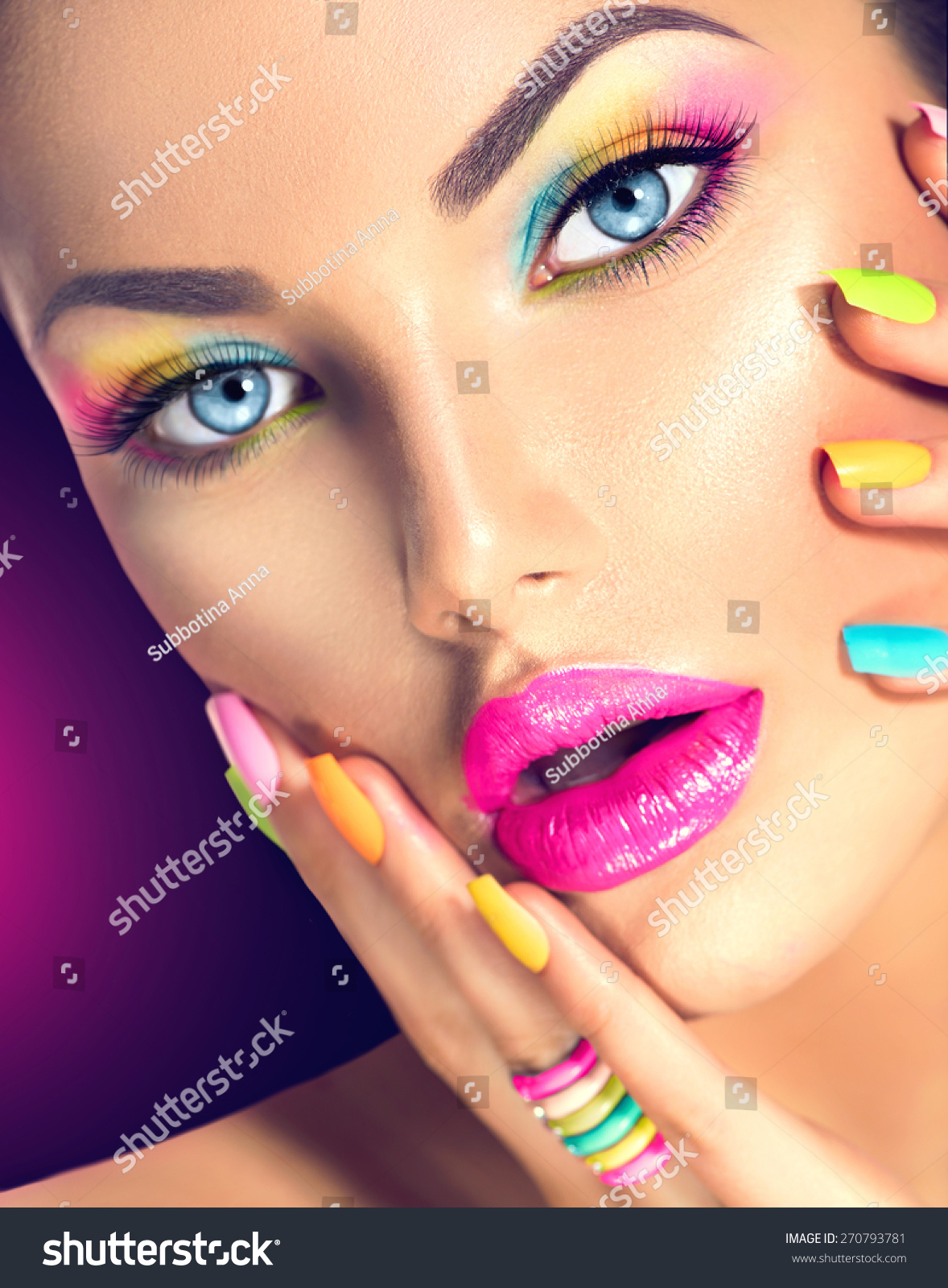 Beauty Girl Face With Vivid Makeup And Colorful Nail