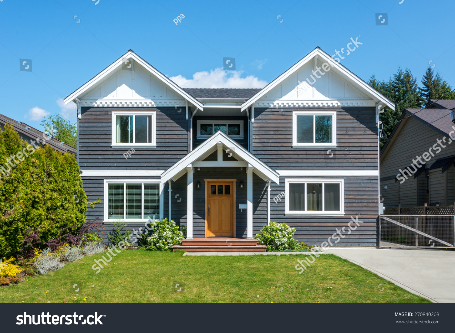 luxury house with beautiful landscaping on a sunny day home exterior - Luxury House Exterior