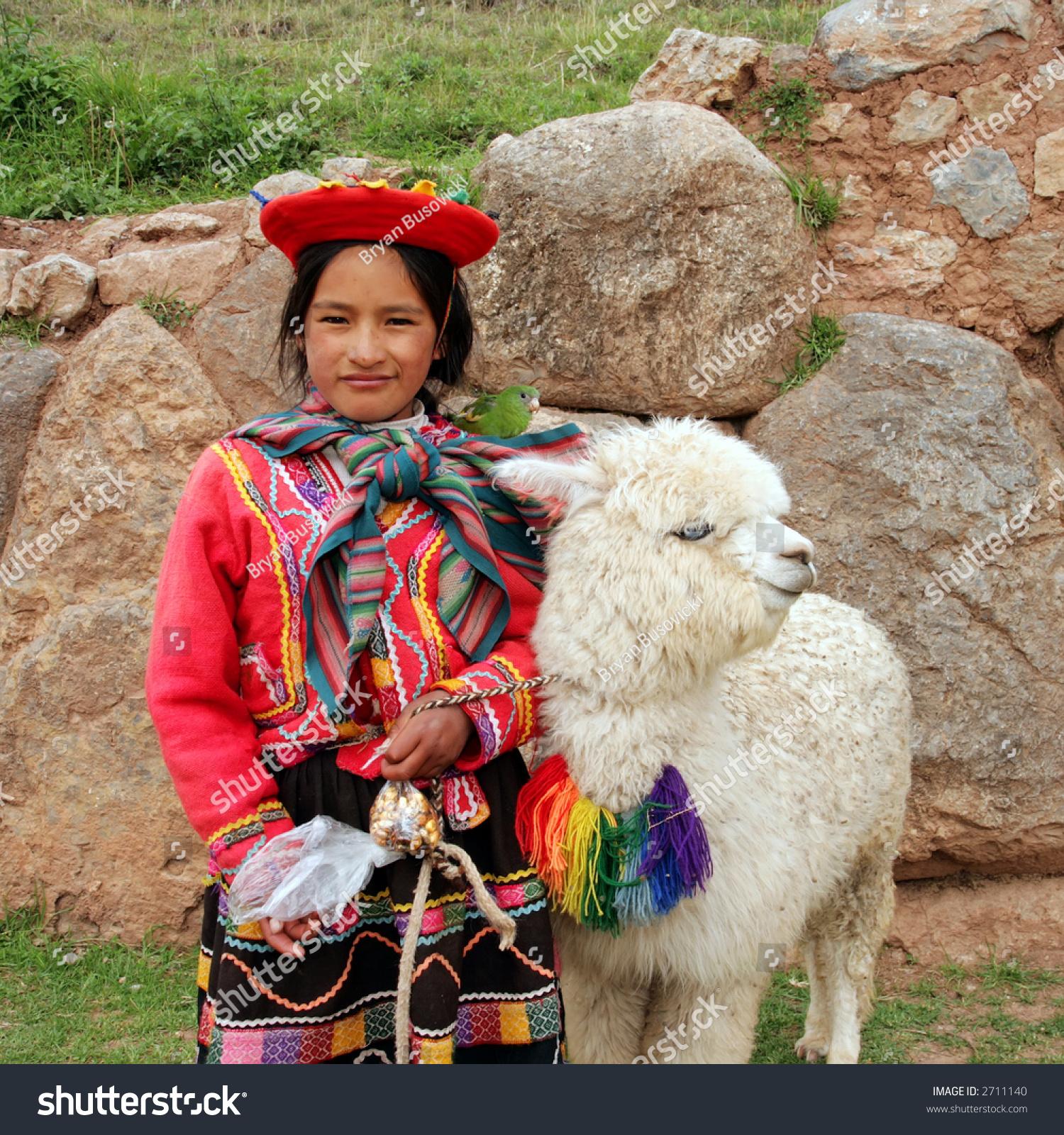Peru Travel Tips Common Peruvian Phrases For Travel: Peruvian Girl Traditional Dress Ruins Bird Stock Photo
