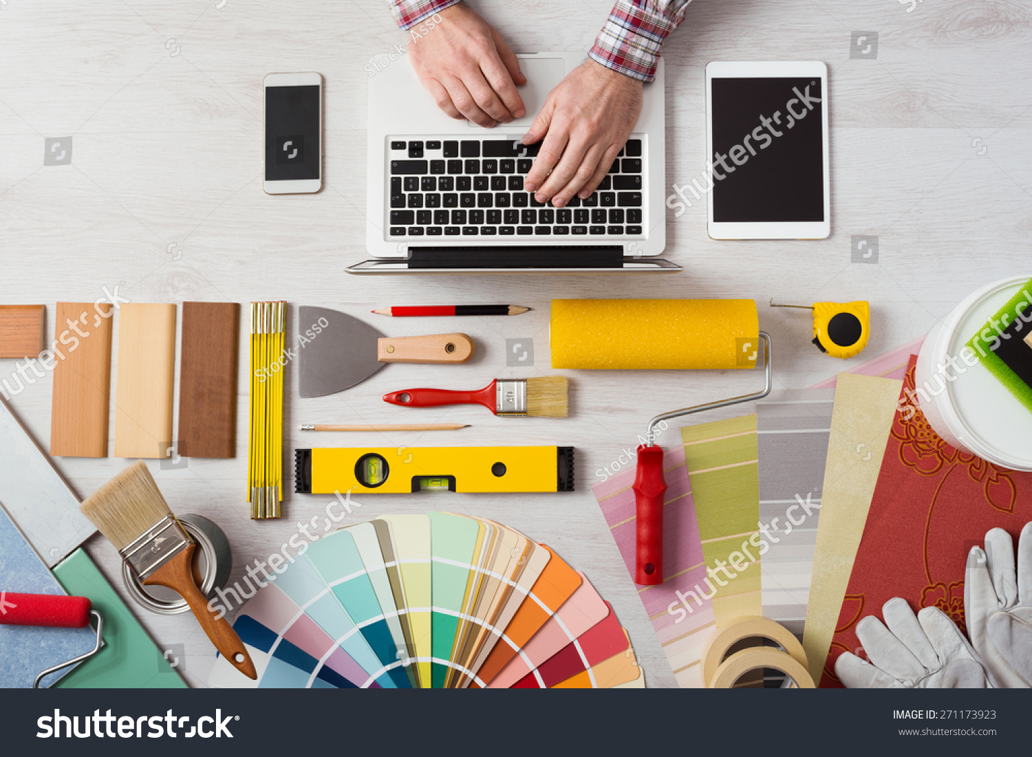 Professional decorator 39 s hands working at his desk and for Professional decorator