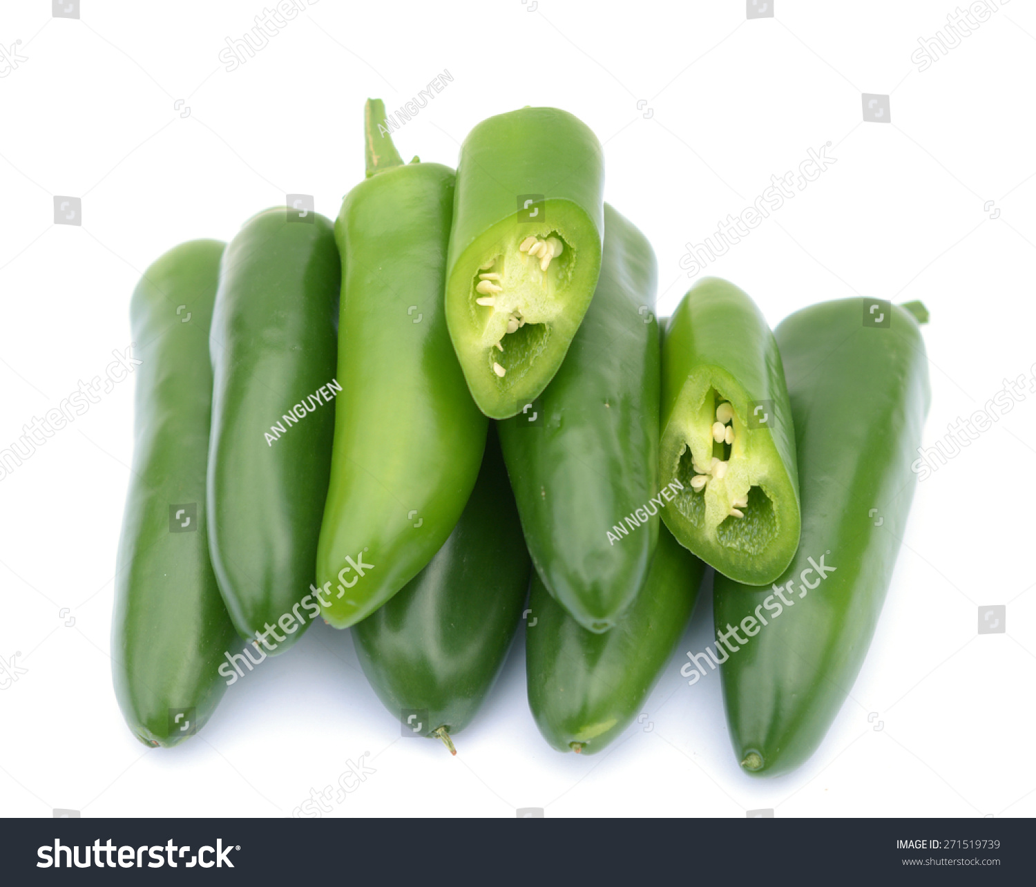 chopped whole green jalapeno peppers on stock photo