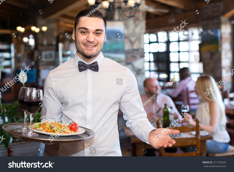 happy smiling handsome waiter restaurant holding stock photo