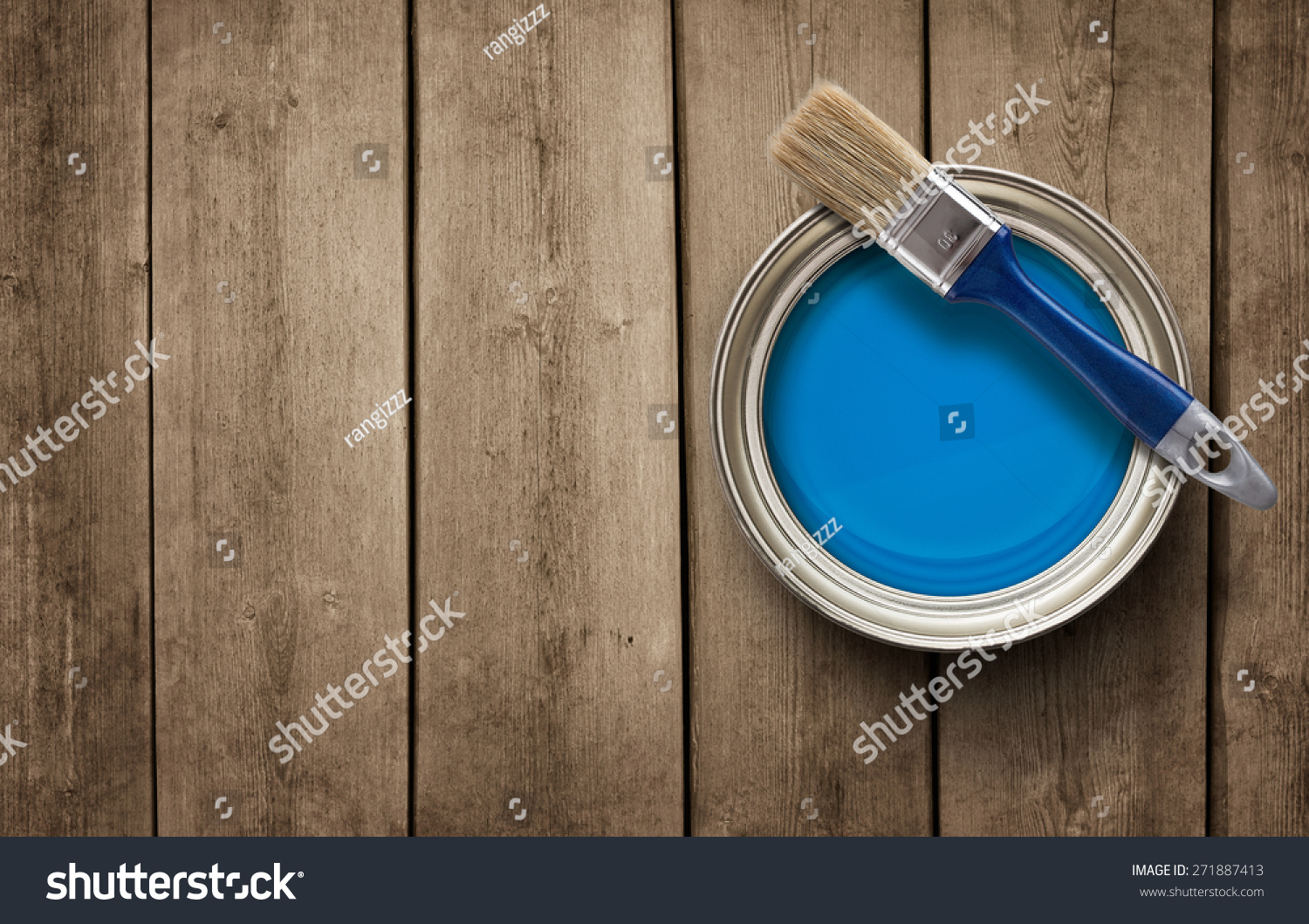 House renovation, paint can on the old wooden background with copy space #271887413