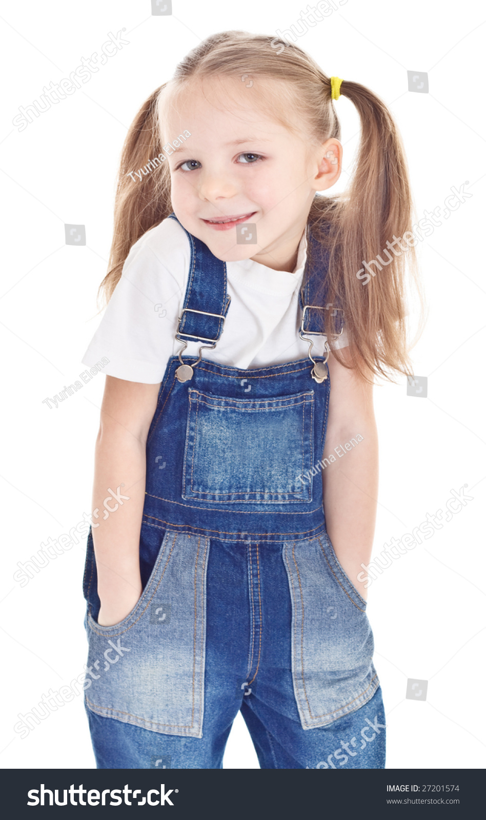 smiling little girl blue jeans overalls stock photo