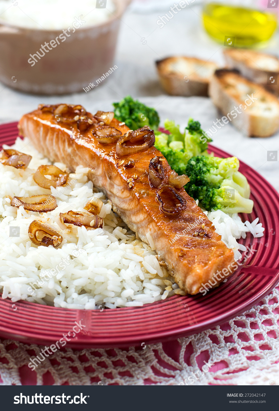 Maple glazed salmon with caramelized onions served with rice ...