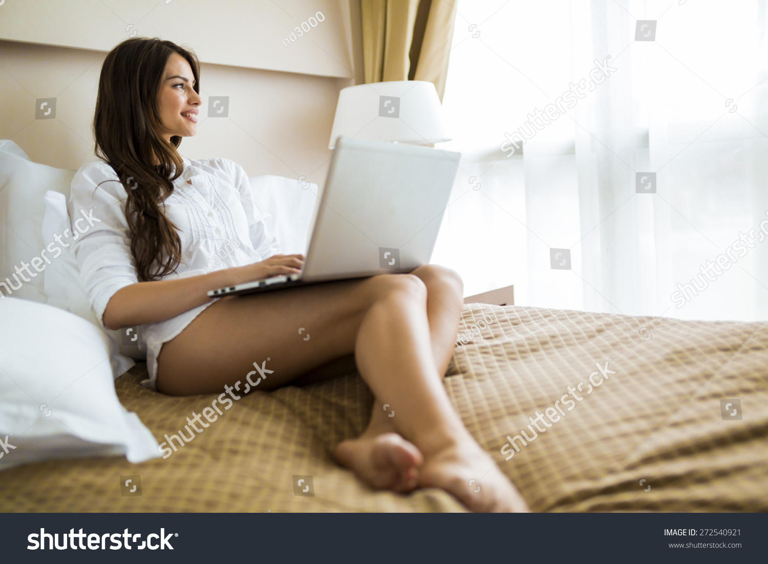 Beautiful young woman sexy long legs stock photo 272540921 for Sexy bed photos