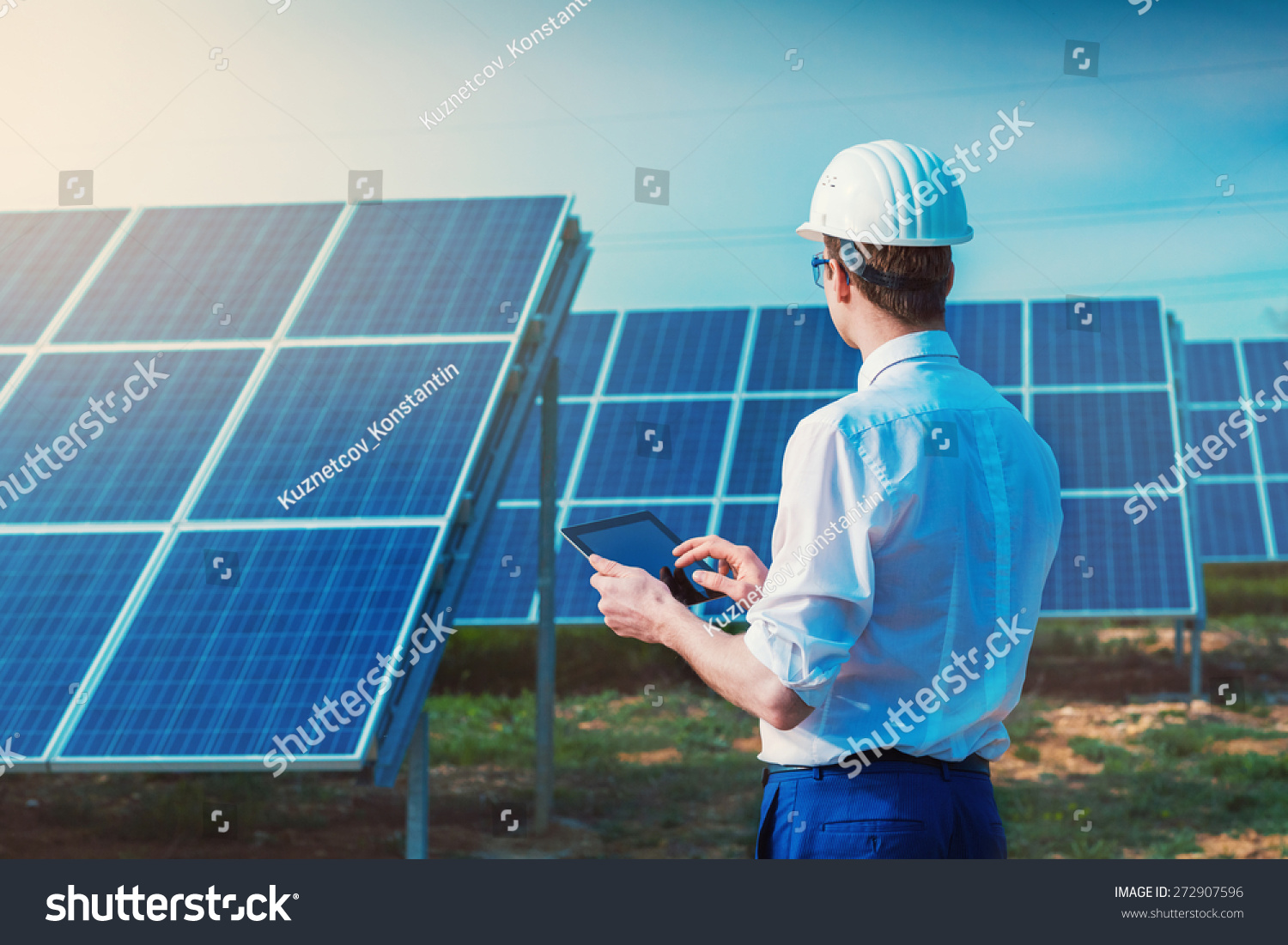 solar power plant engineer with tablet computer on a background of photovoltaic panels science - Power Plant Engineer