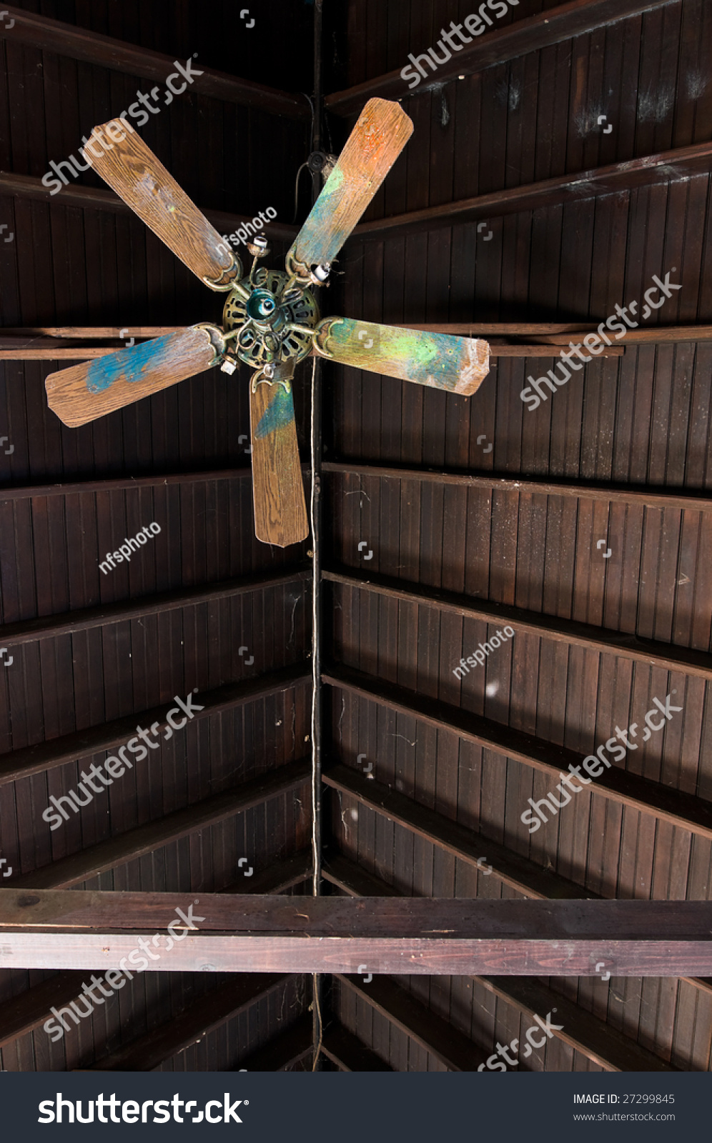 Broken Ceiling Fan In Abandoned Building Shot Straight Up Towards The Exposed Wood Roof