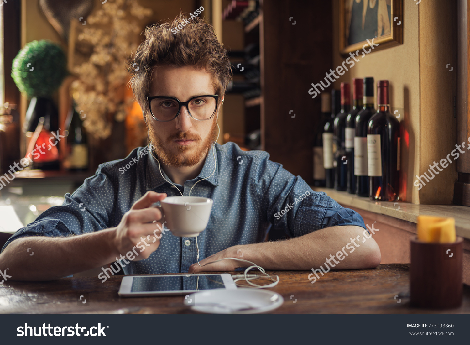 Nerd Hipster Guy With Glasses Sitting At Bar Table And ...