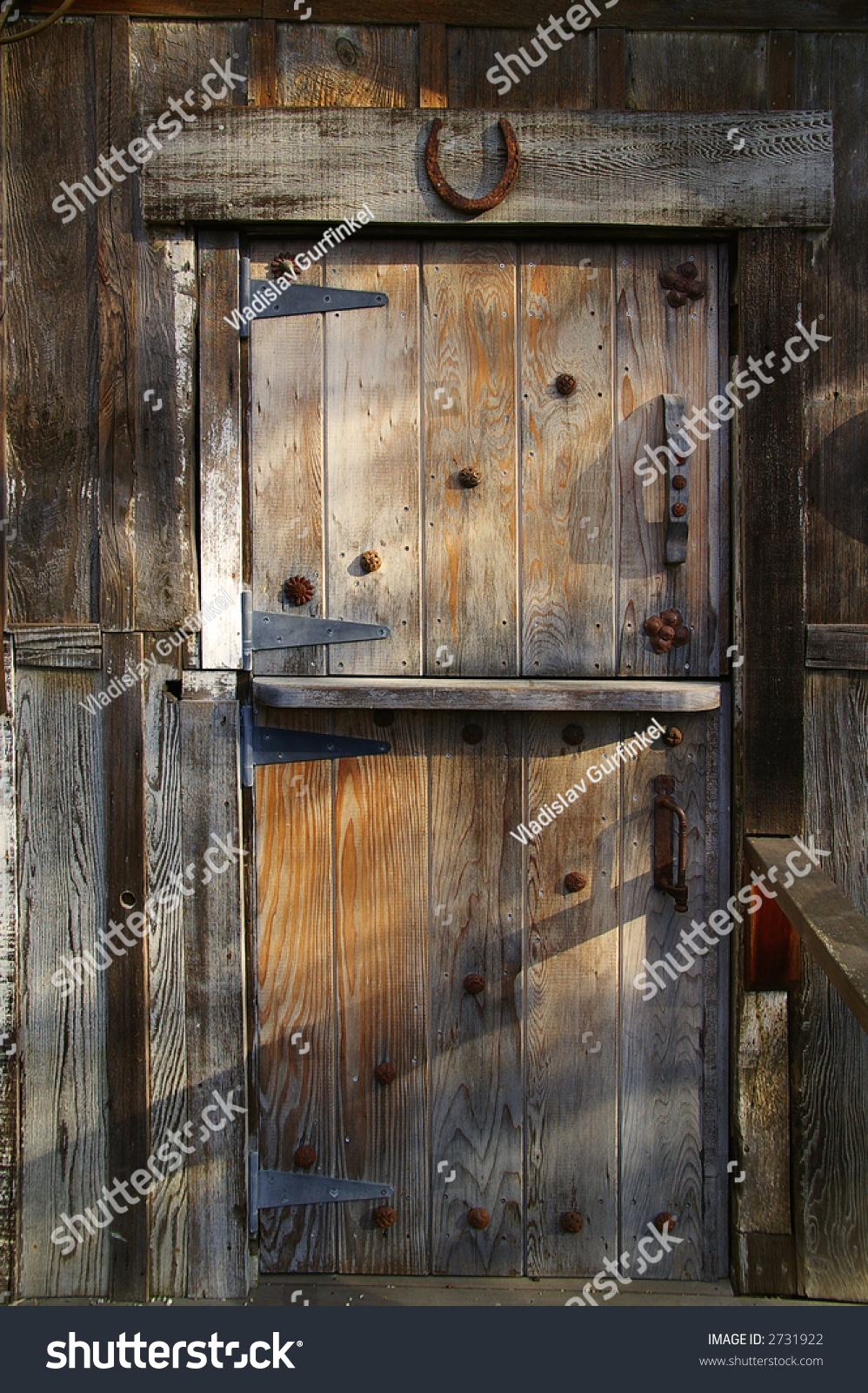 Rustic Wooden Barn Door With Rusty Metal Handles And