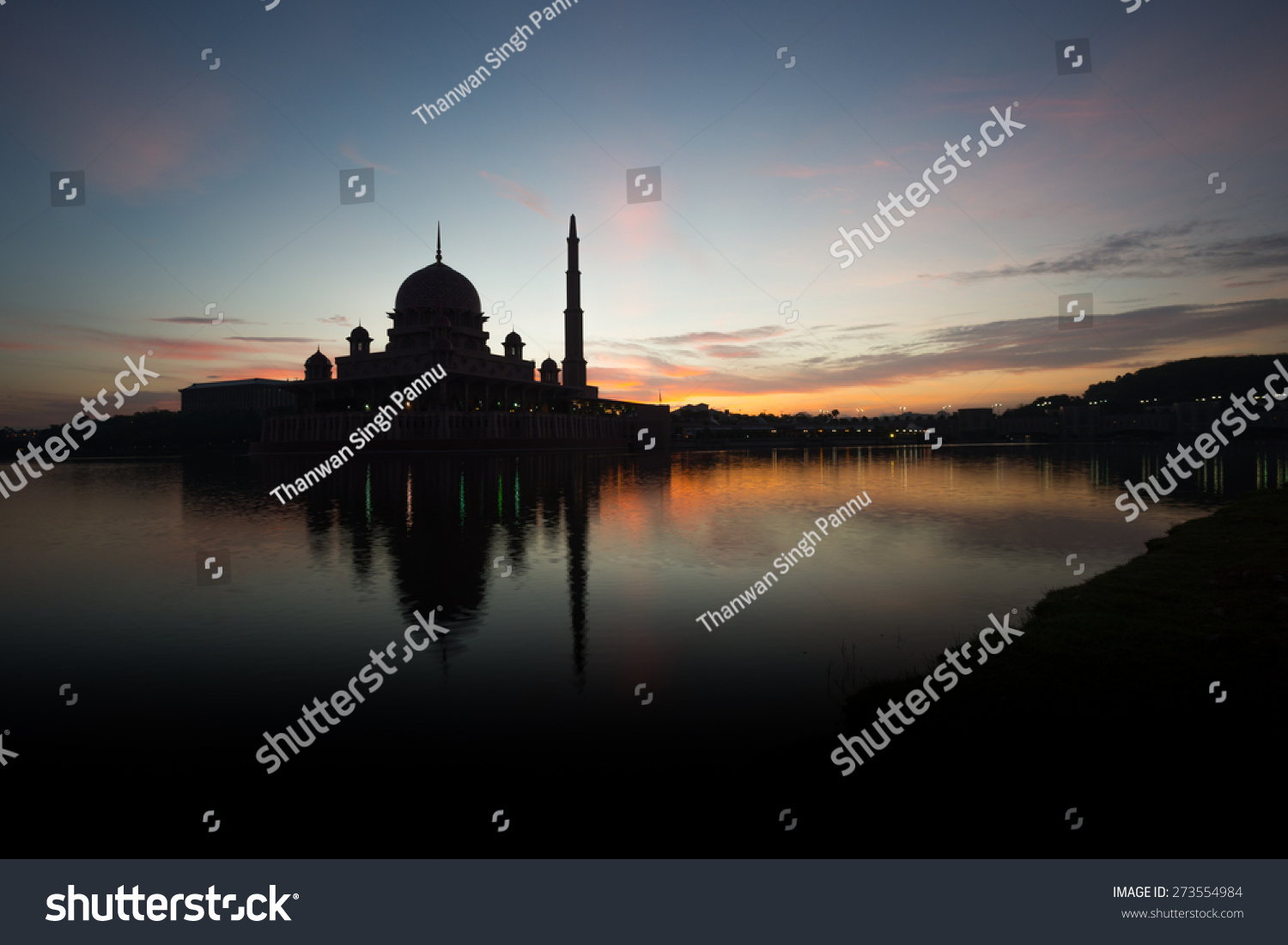 A silhouette of a mosque / The Putra Mosque silhouette  / A mosque at dawn / Sunrise clouds above mosque #273554984