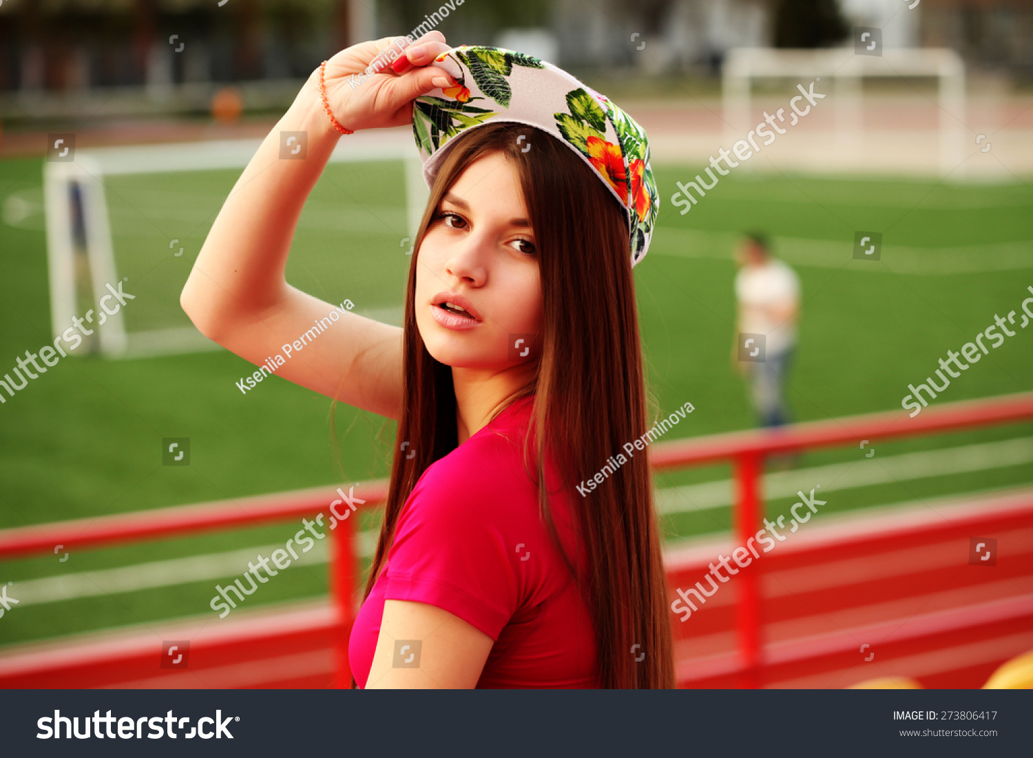 beautiful swag girl posing on the football stadium Preview. Save to a  lightbox