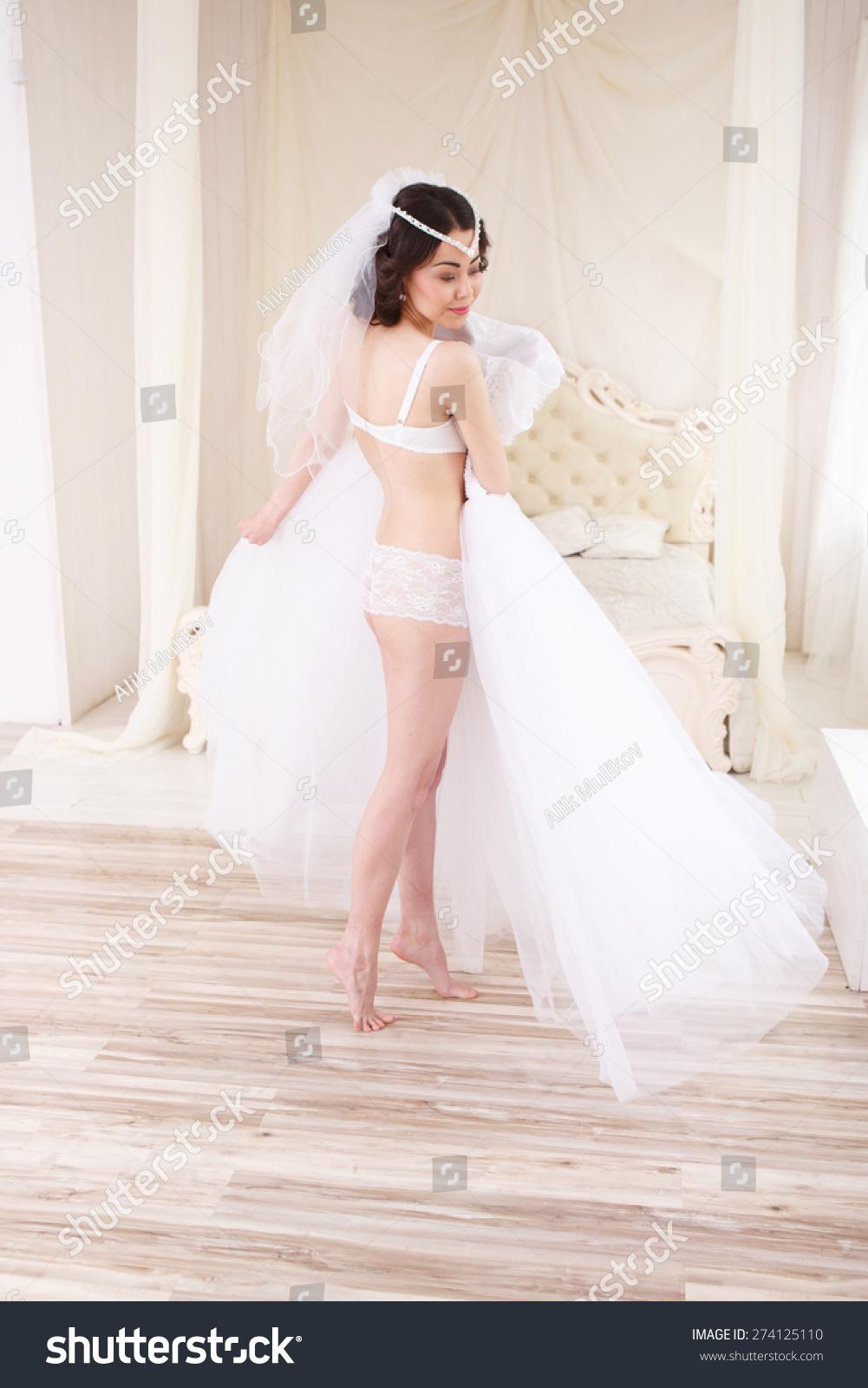Beautiful Bride Lingerie Trying Wedding Dress Stock Photo (Royalty ...