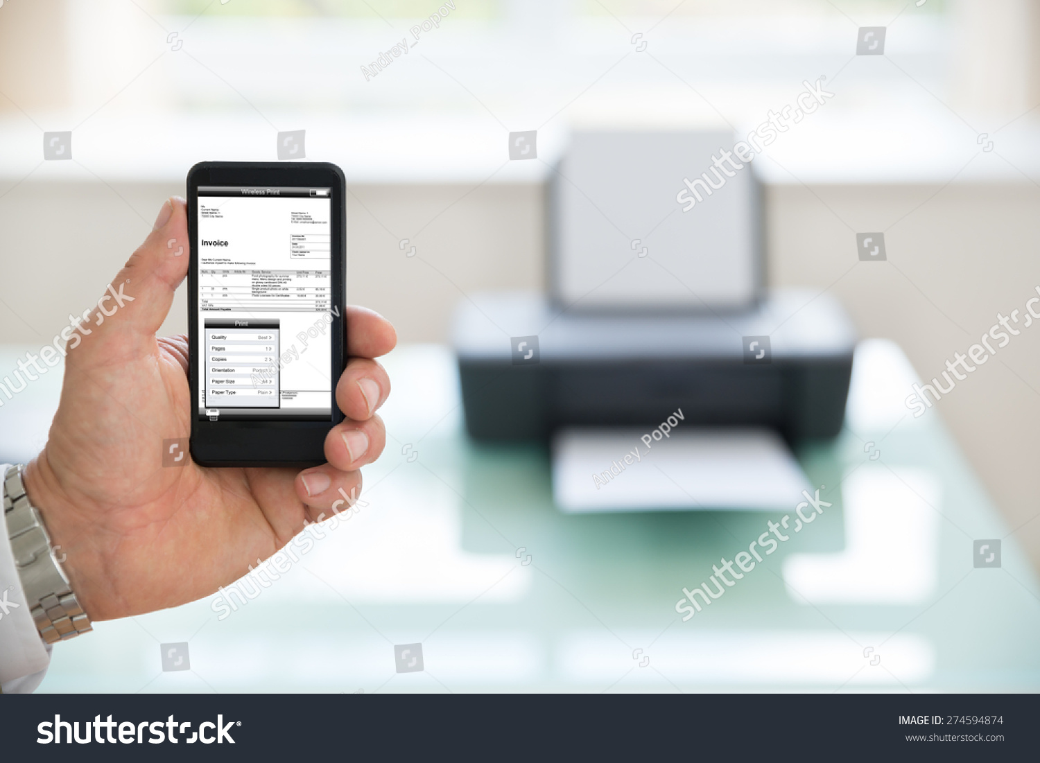 Close-up Of A Businessman Using Cellphone For Printing Invoice Photographer owns copyright for images on screen