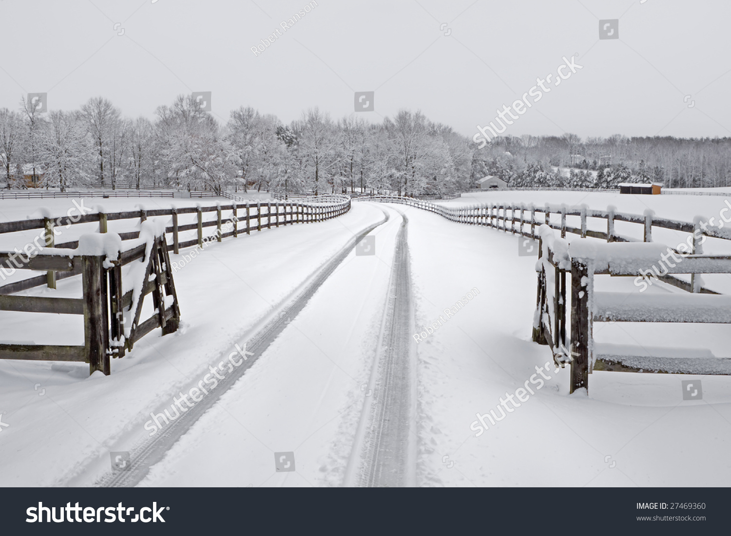 Snow Covered Countryside Driveway Wooden Fencing Stock