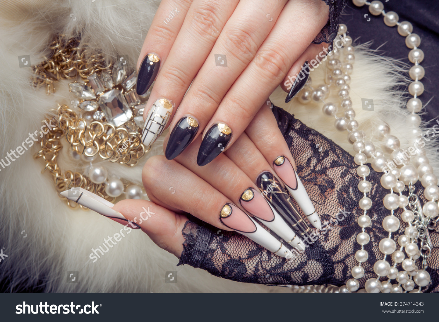 Royalty-free Retro jewels and extreme long nails on… #274714343 ...