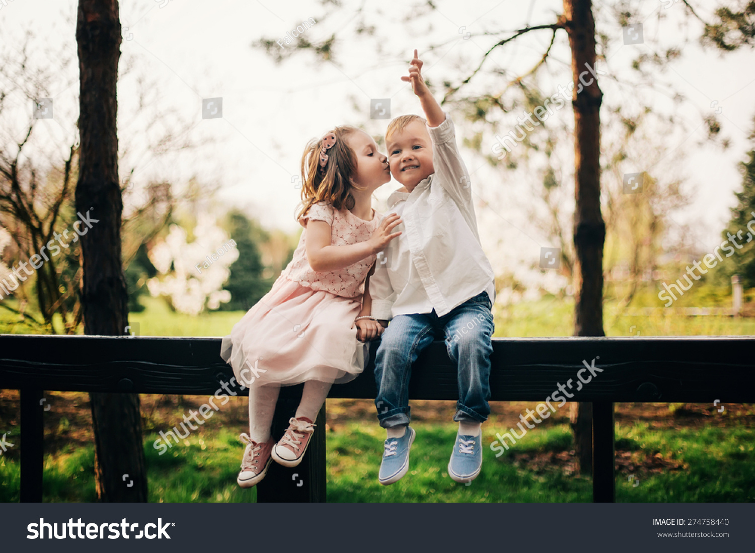 cute love little girl kissing little stock photo (royalty free