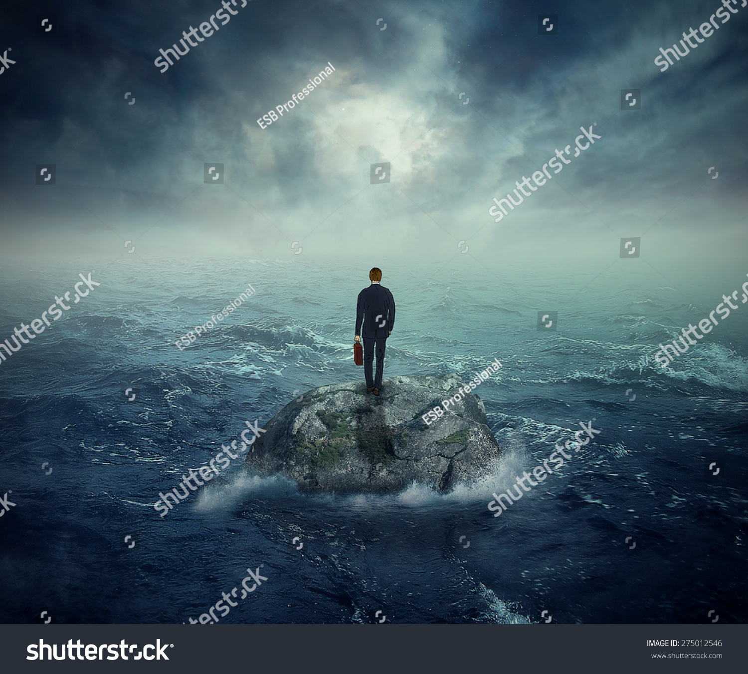 Failure crisis concept and lost business career education opportunity Lonely young man on a rock cliff island surrounded by an ocean storm waves