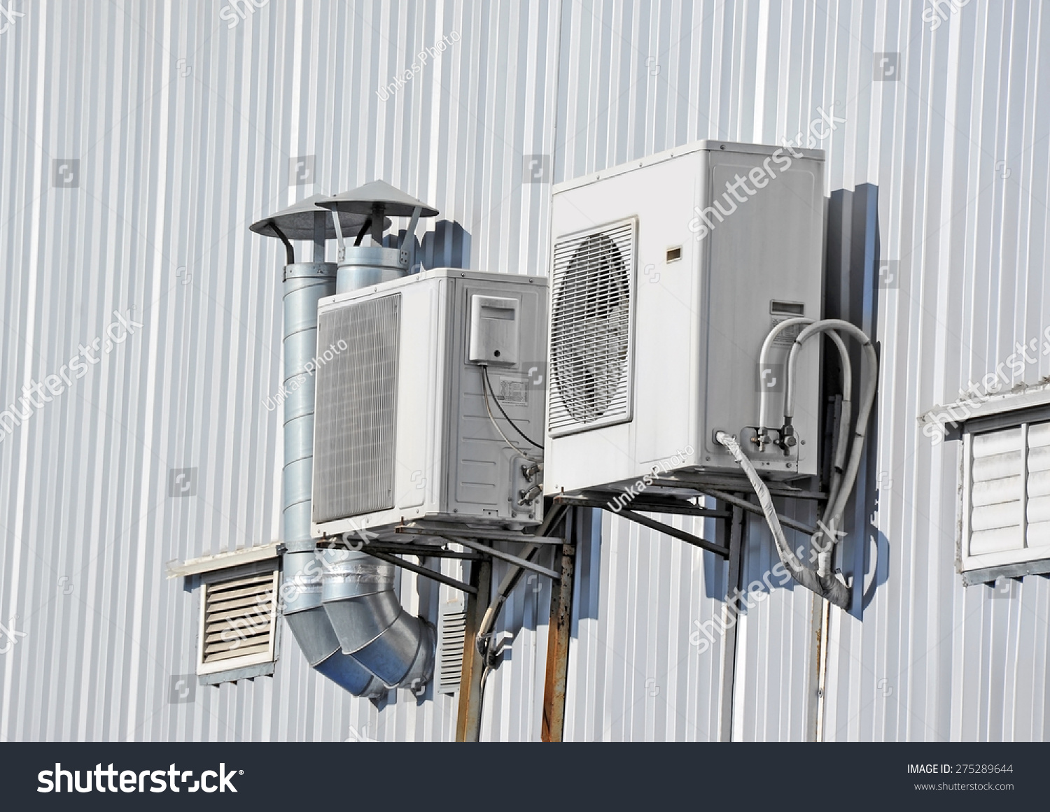Industrial Air Conditioning And Ventilation Systems On A Wall Stock  #7C6247