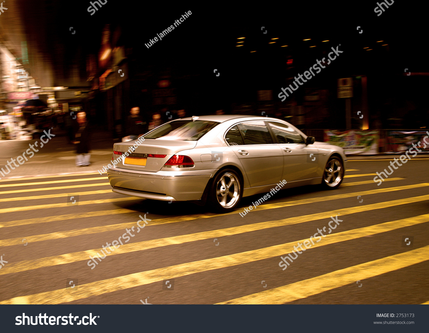 High End Luxury Cars: High End Luxury Car On Hong Kong Streets. Stock Photo