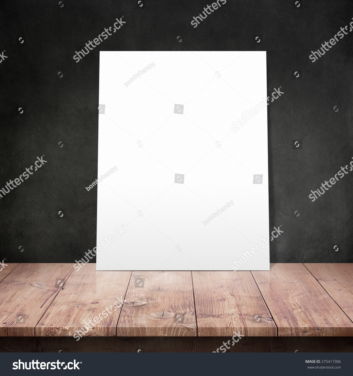 White Poster On A Wooden Table With Concrete Wall Background Stock ...