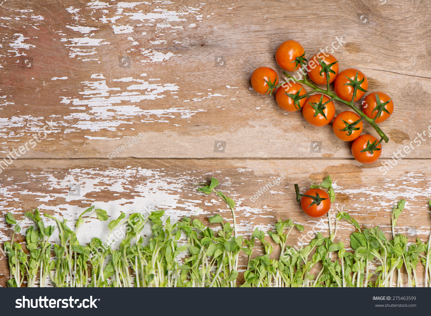 Tomato with pea sprout on wood top stock photo