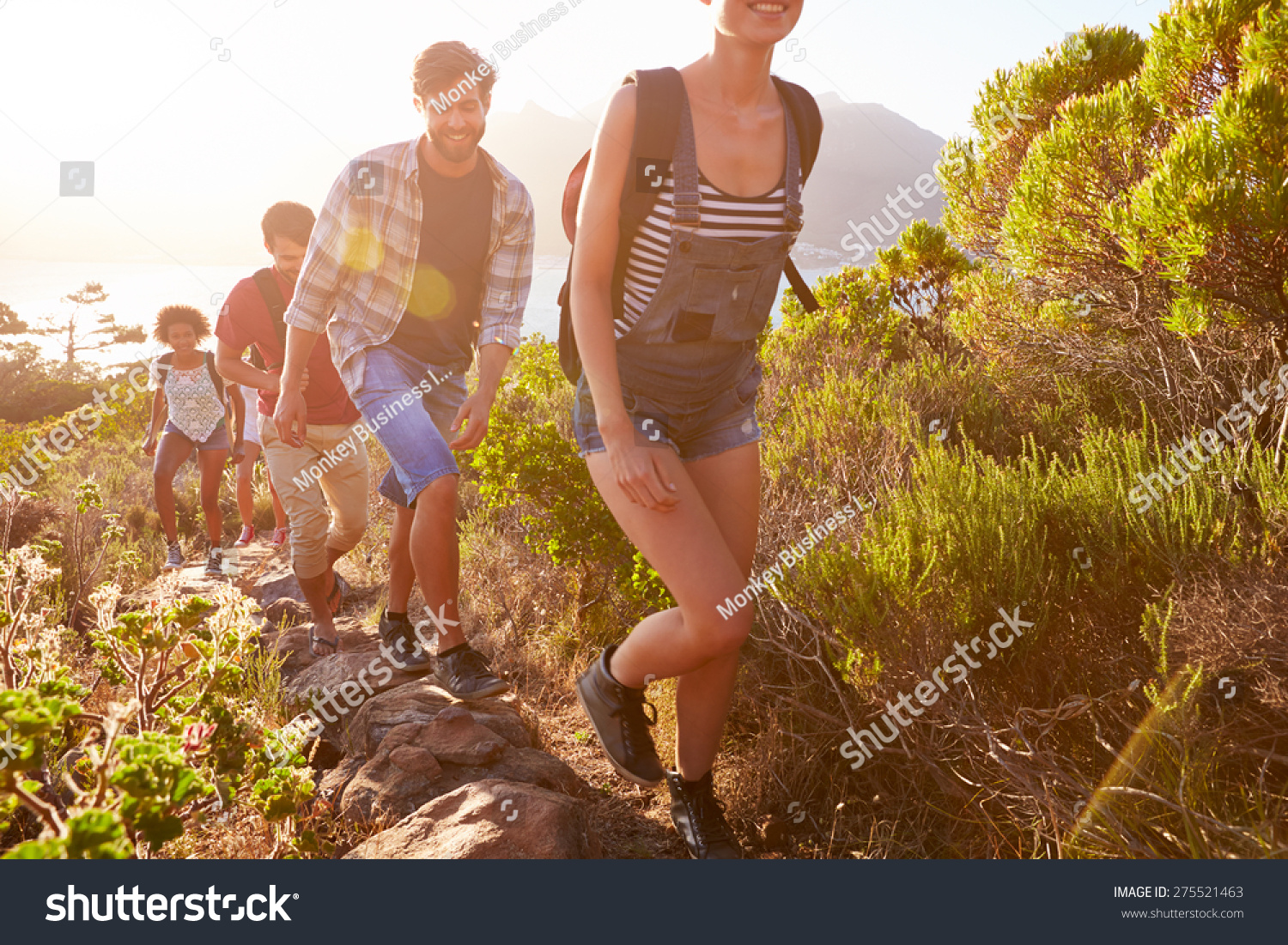 Group Of Friends Walking Along Coastal Path Together #275521463