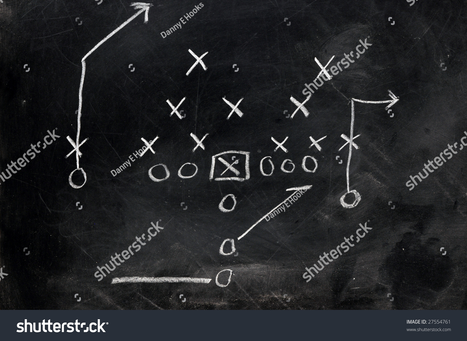 diagram of football play on black chalkboard  stock photo      diagram of football play on black chalkboard  preview  save to a lightbox