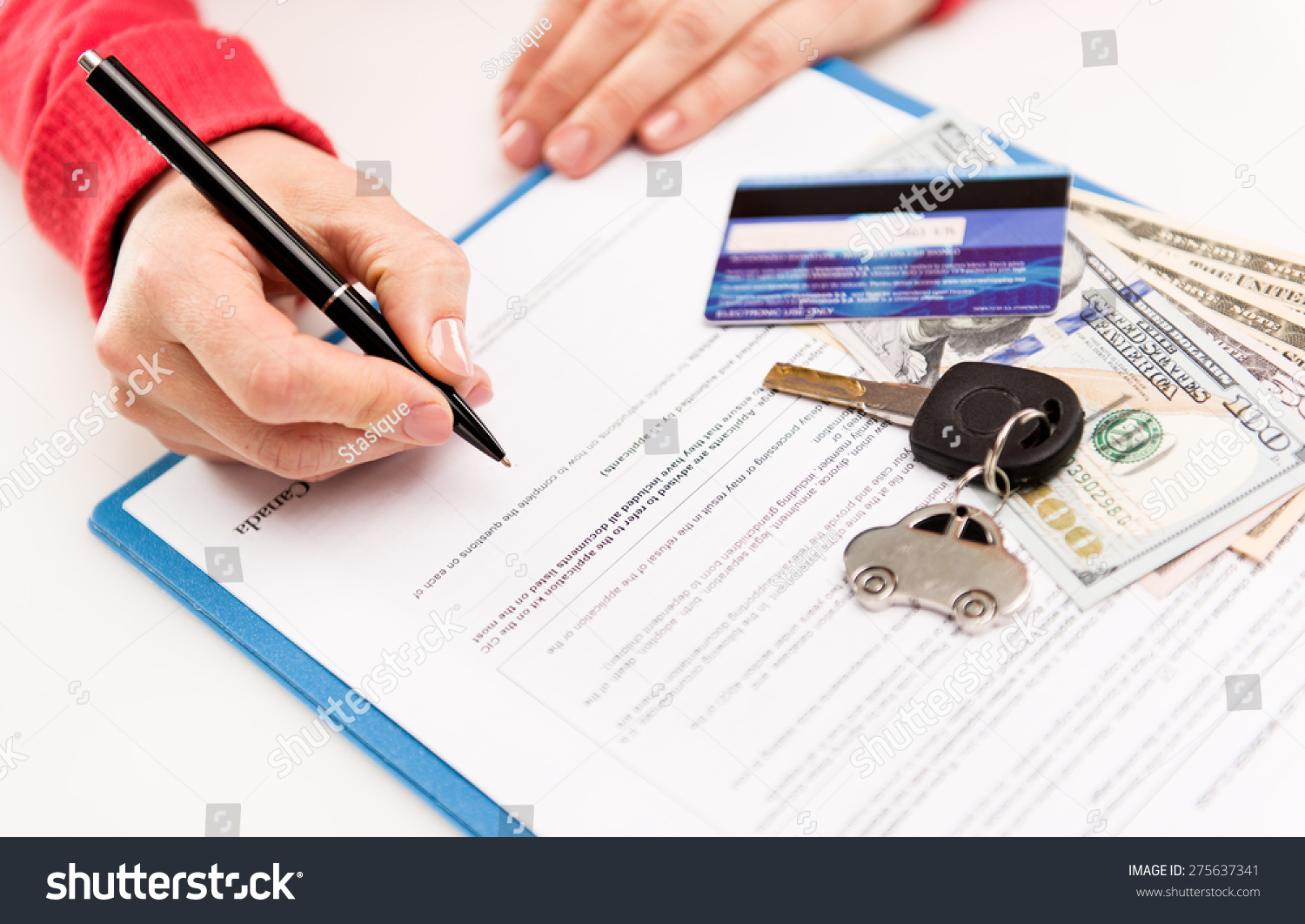 Young Female Leasing Consultant Signing Car Stock Photo