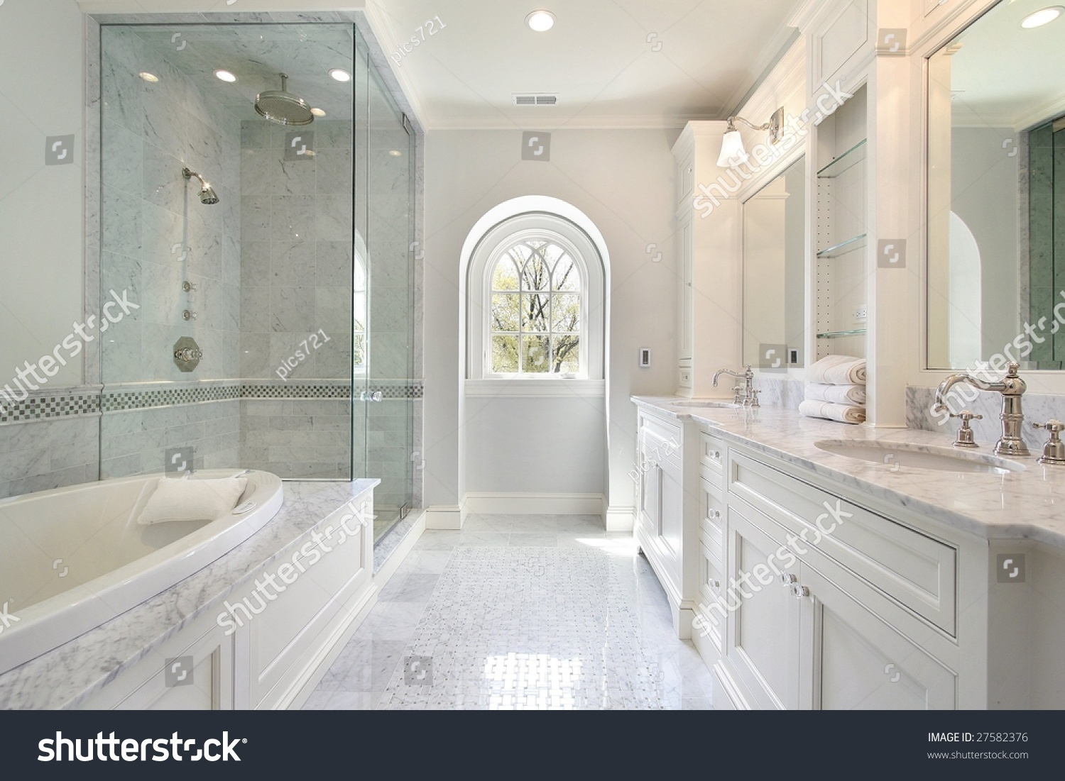 luxury master bath with bath and glass shower stock photo 27582376