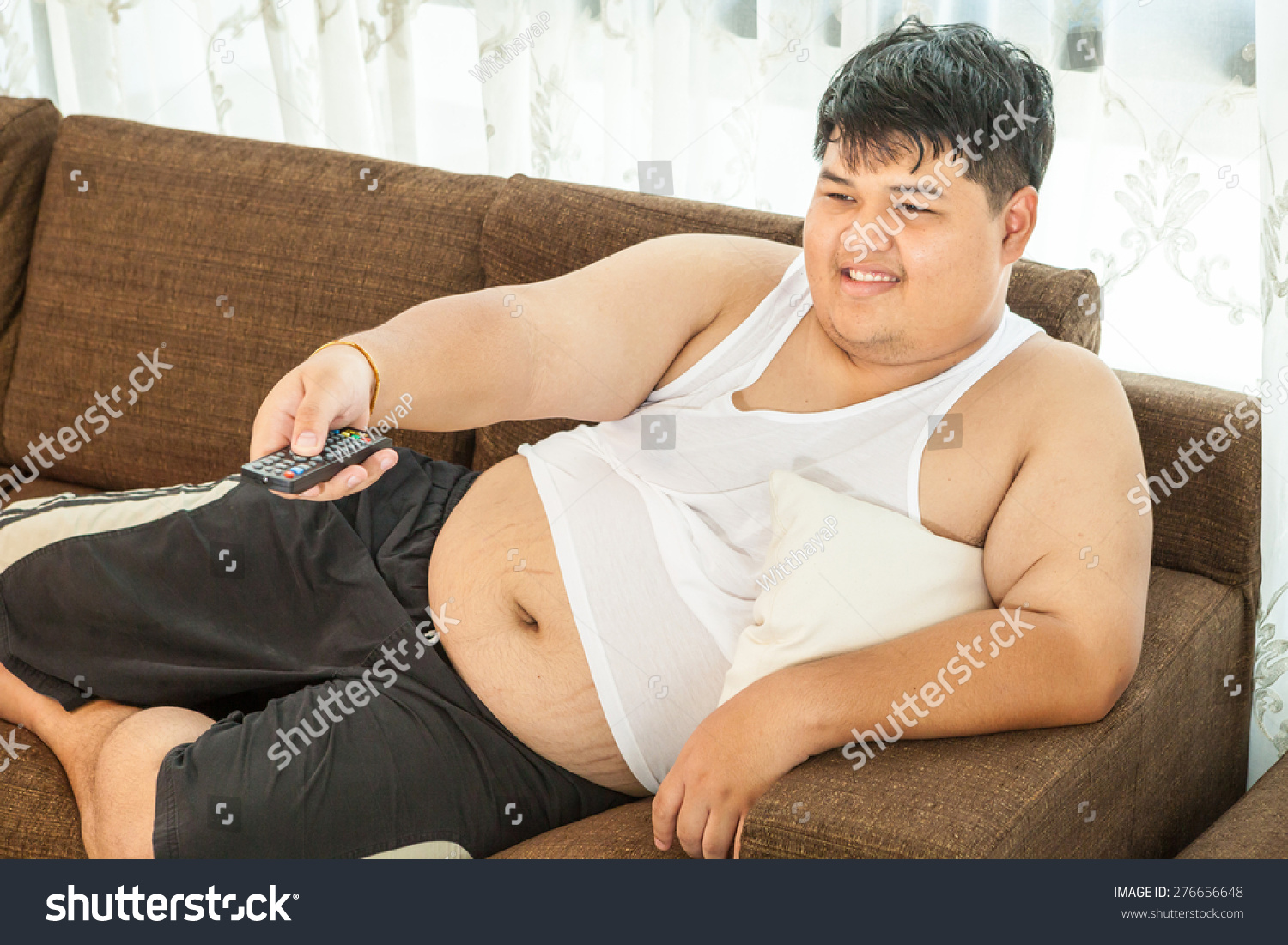 Overweight Asian Guy Sitting On Couch Stock Photo 276656648 ...