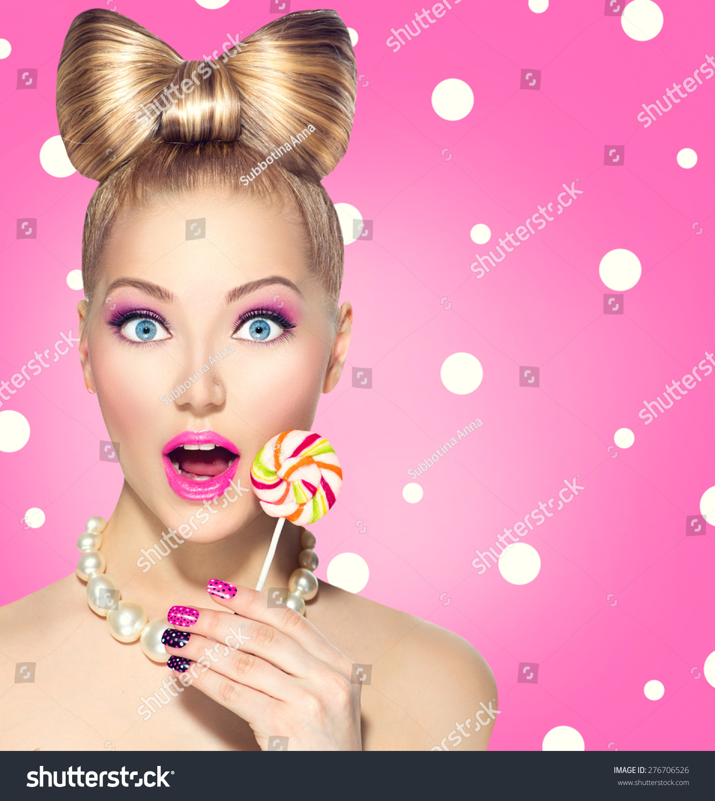... colourful lollipop. Surprised Young funny woman with bow hairstyle