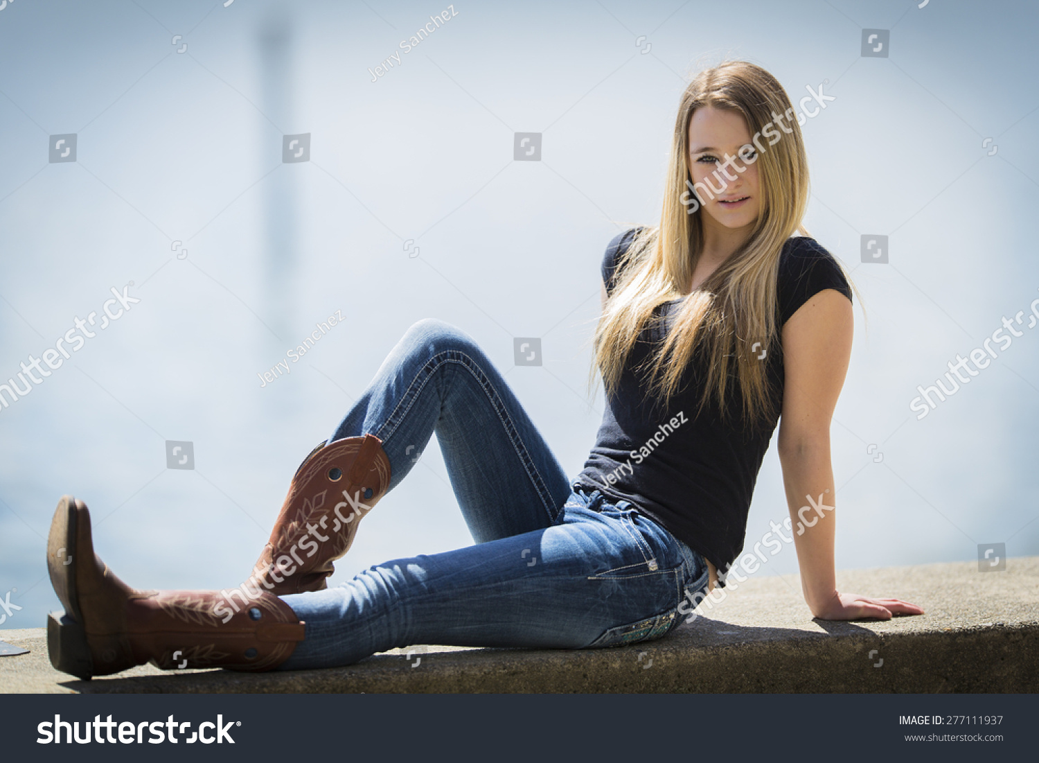 Young Blonde Girl Posing Cowboy Boots