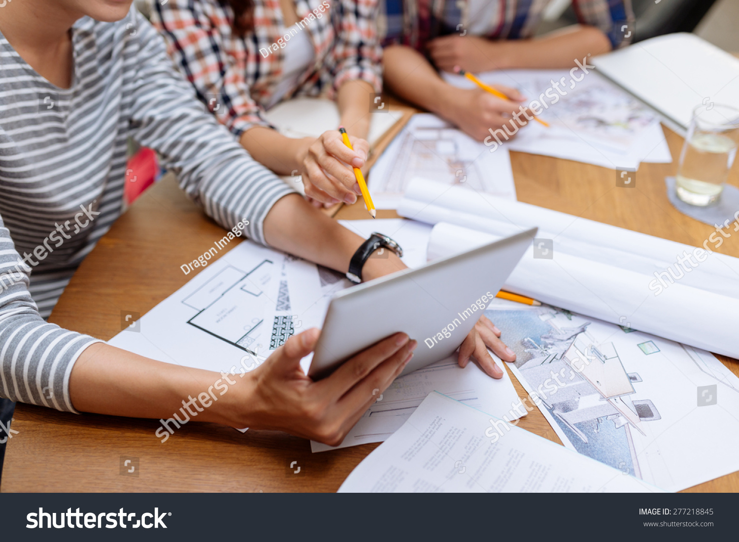 Interior designers using digital tablet meeting stock photo 277218845 shutterstock for Best tablet for interior designers