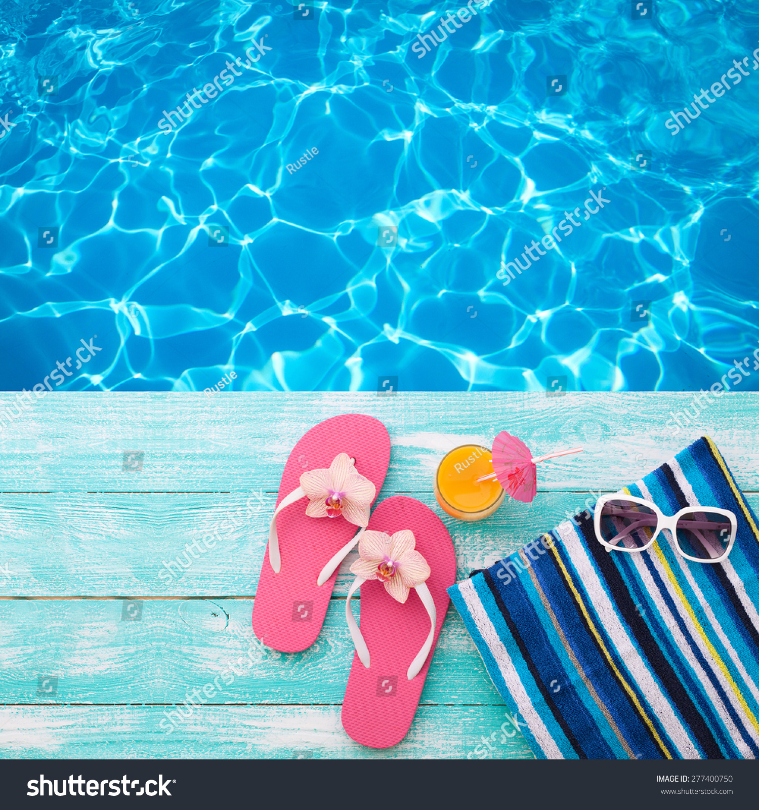 792d9f390 Summer vacation. Pink sandals by swimming pool. Blue sea surface with  waves