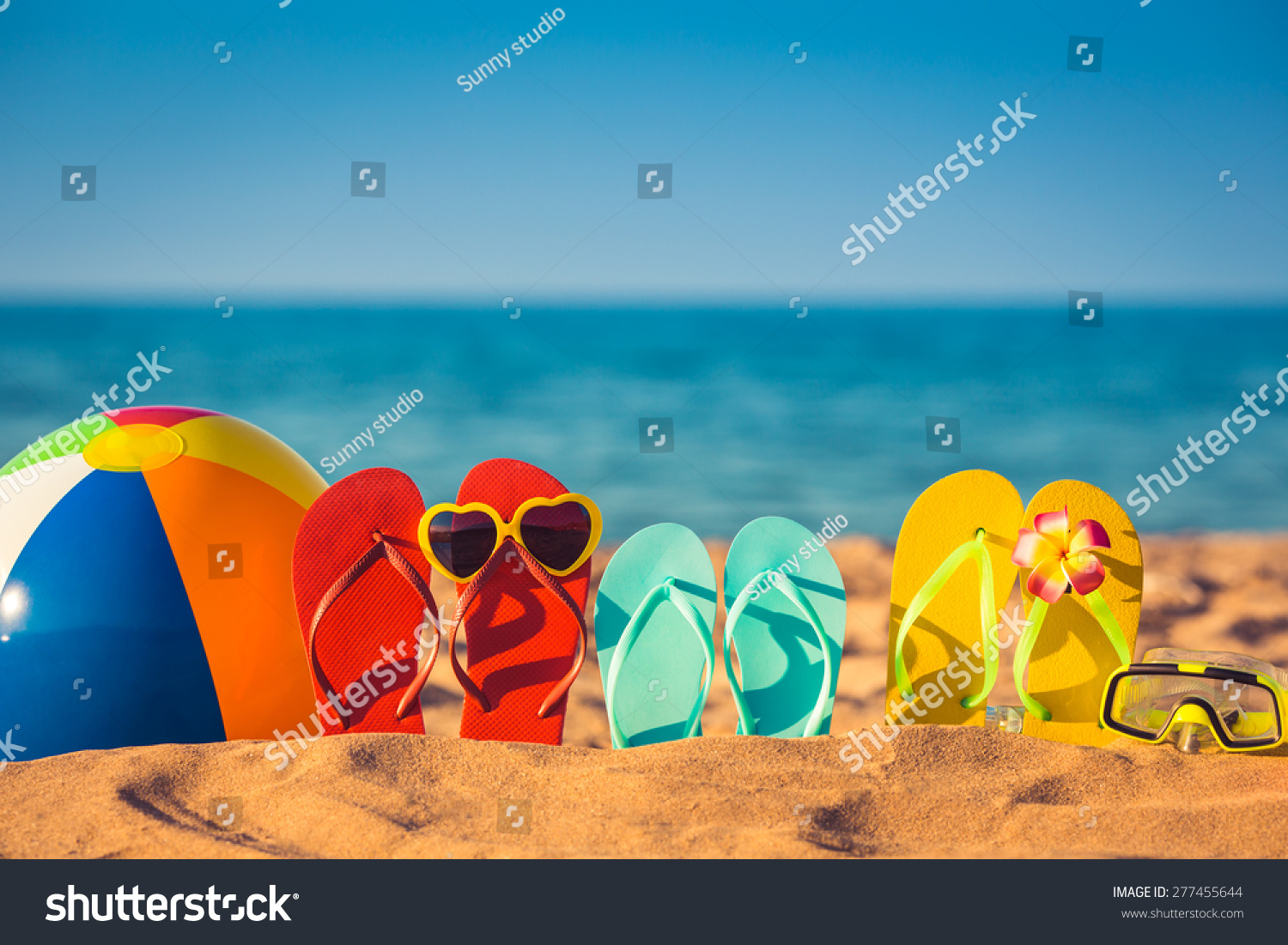 Flip-flops, beach ball and snorkel on the sand. Summer vacation concept #277455644 - 123PhotoFree.com