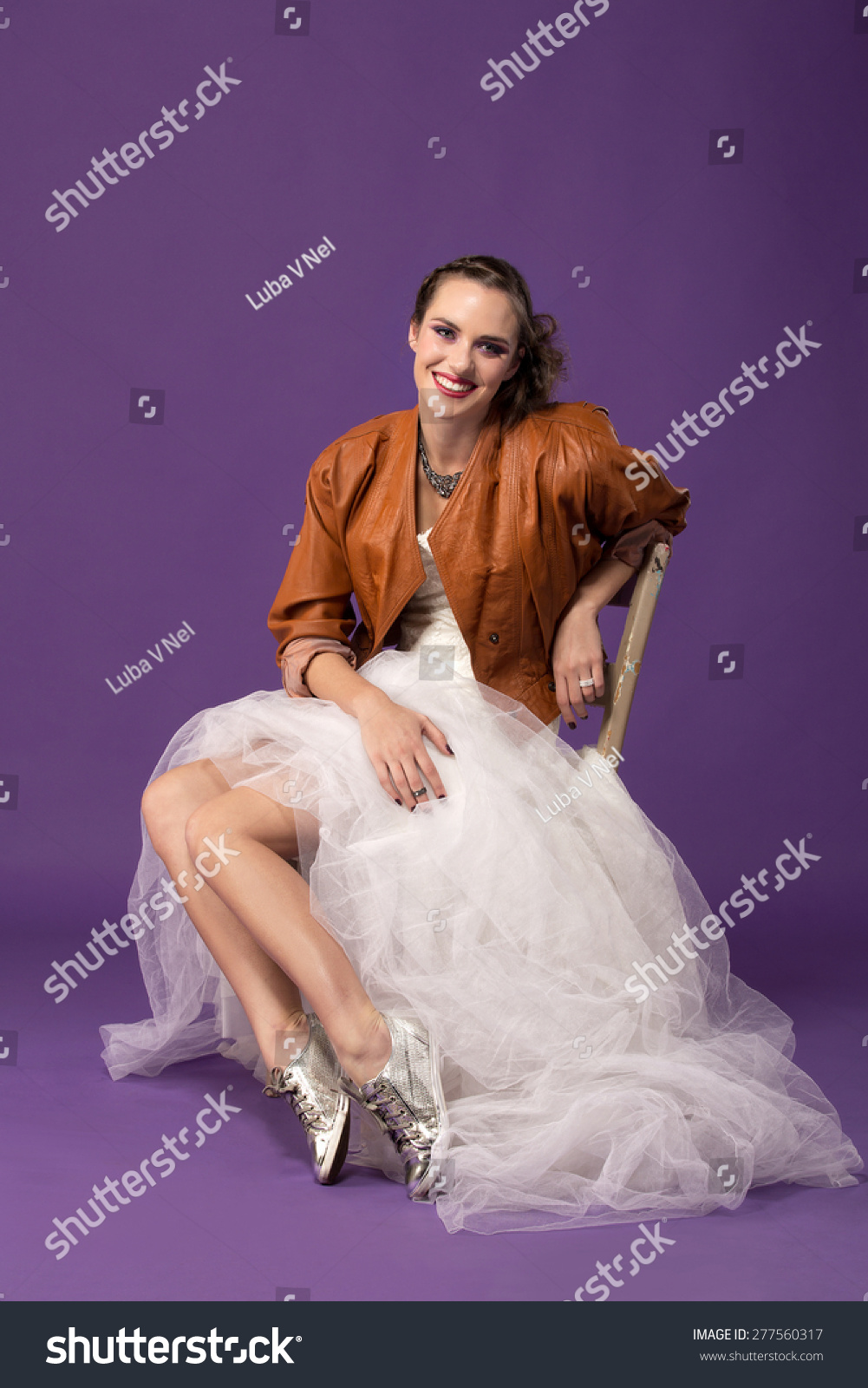 bd815e9f3c739 portrait of modern bride with tulle wedding dress wearing sequin shoes and  leather jacket sitting against
