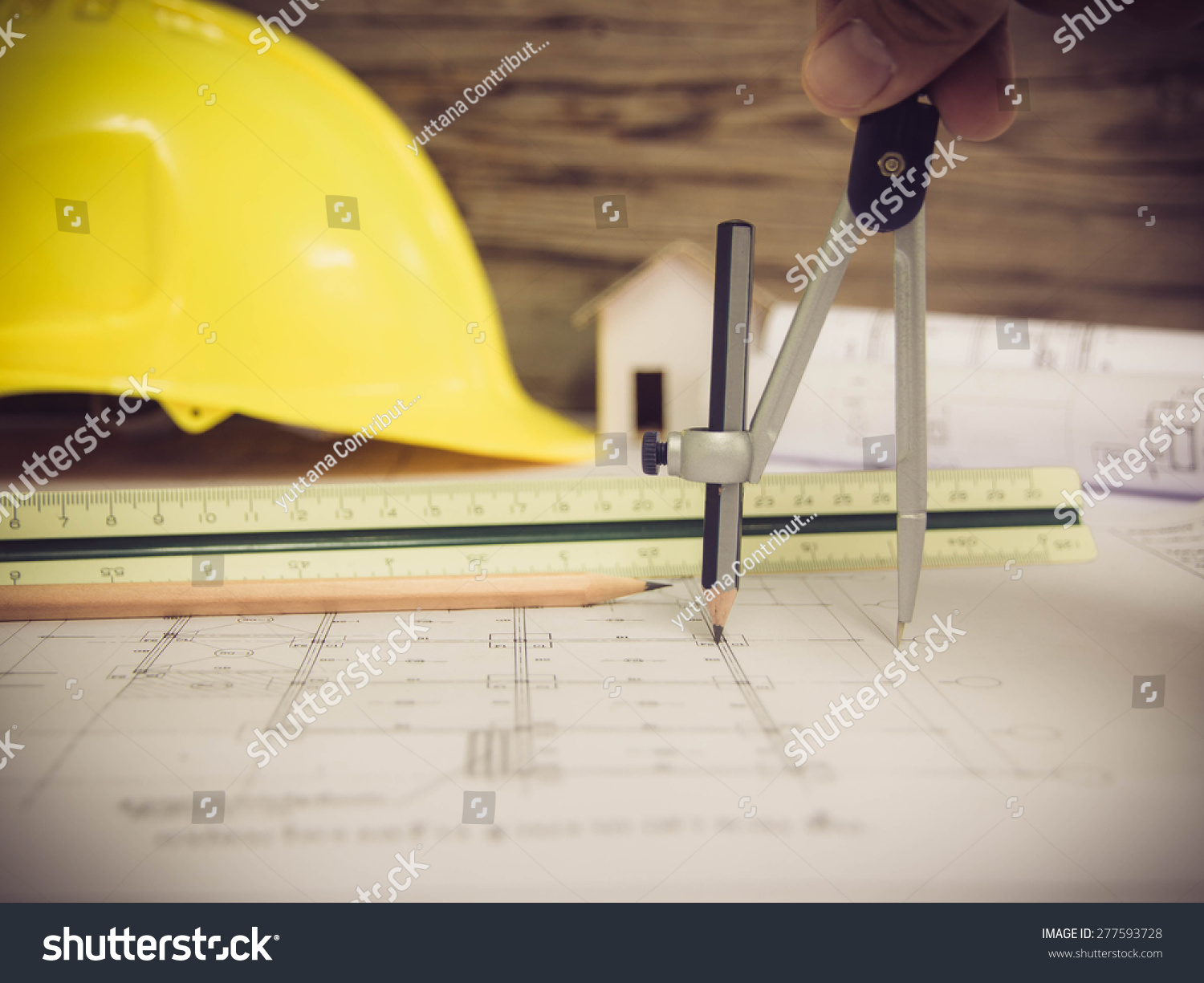 Architectural blueprint office building pencil still stock photo architectural blueprint of office building with a pencil still life malvernweather Image collections