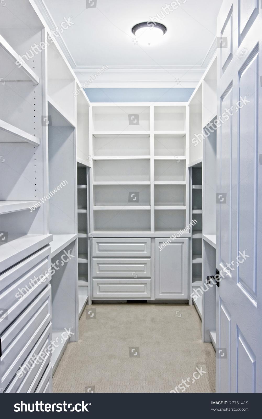 Large white walkin closet shelves stock photo 27761419 for Walk in closet white