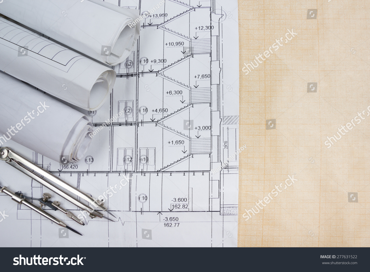 Architectural project blueprints blueprint rolls compass stock architectural project blueprints blueprint rolls compass divider calculator white safety on malvernweather Image collections
