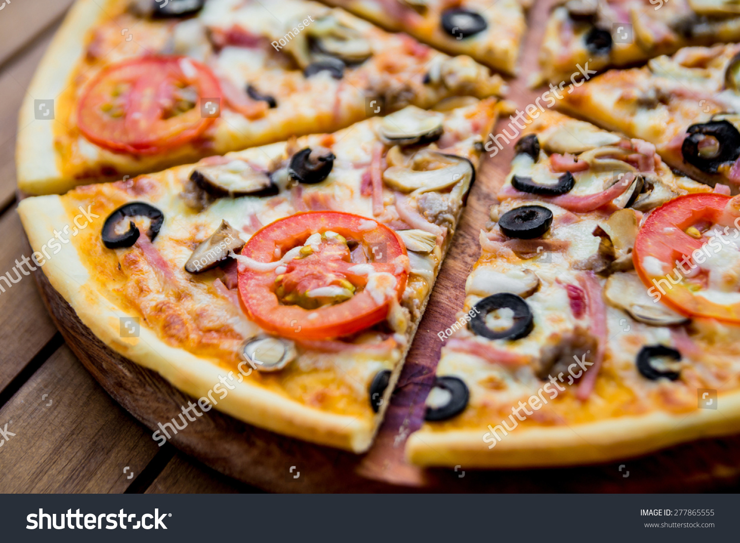 Large pizza on a wooden table restaurant stock photo for Table a pizza