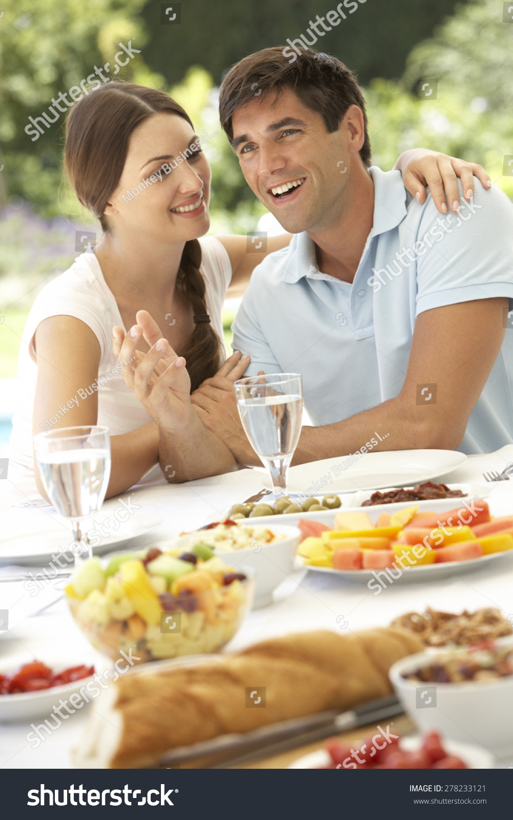 Young couple enjoying meal outdoors stock photo 278233121 for Meal outdoors