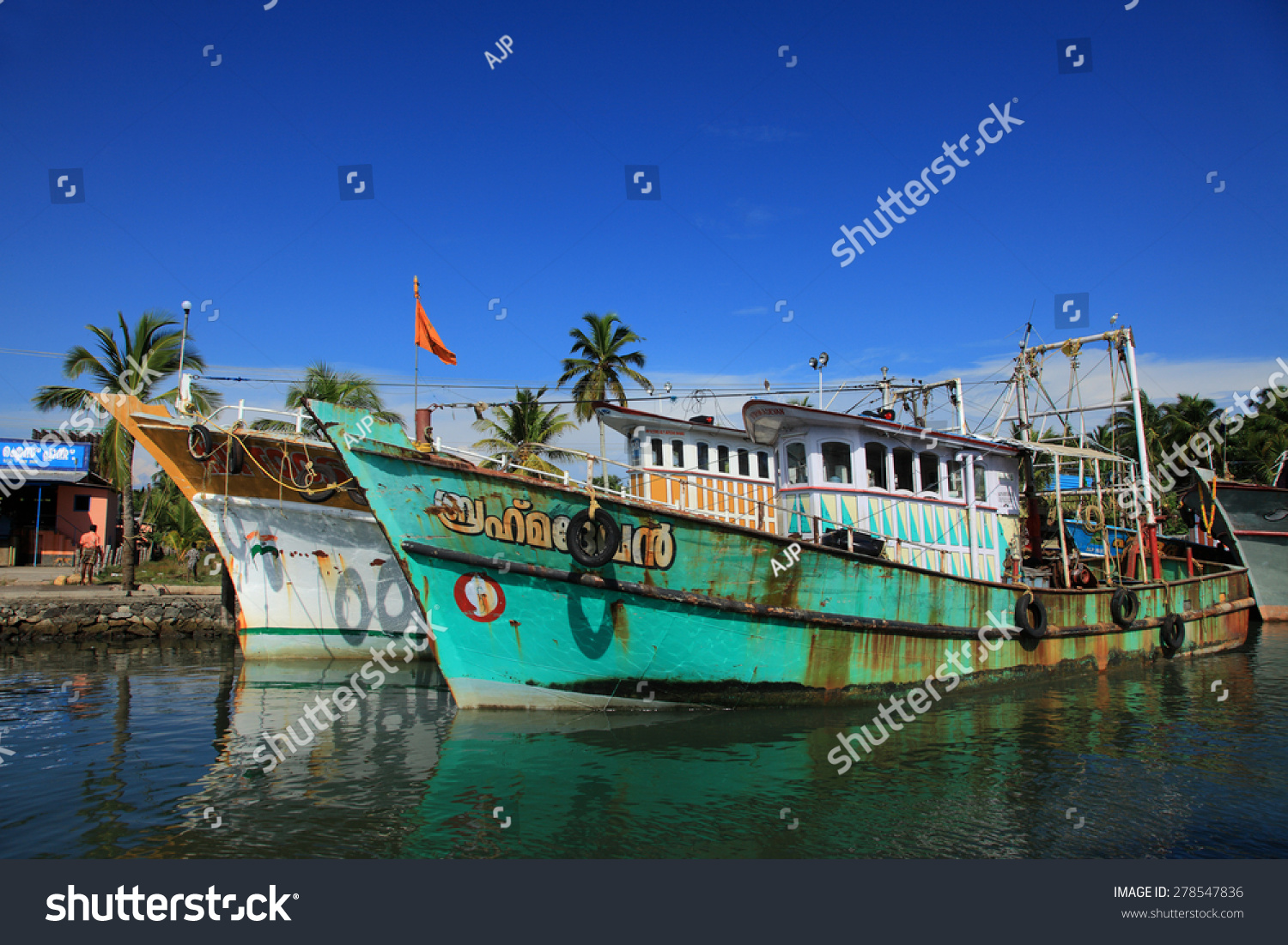 Kollam India  city images : KOLLAM, INDIA APR 17 : Fishing boats are docked in the Ashtamudi ...