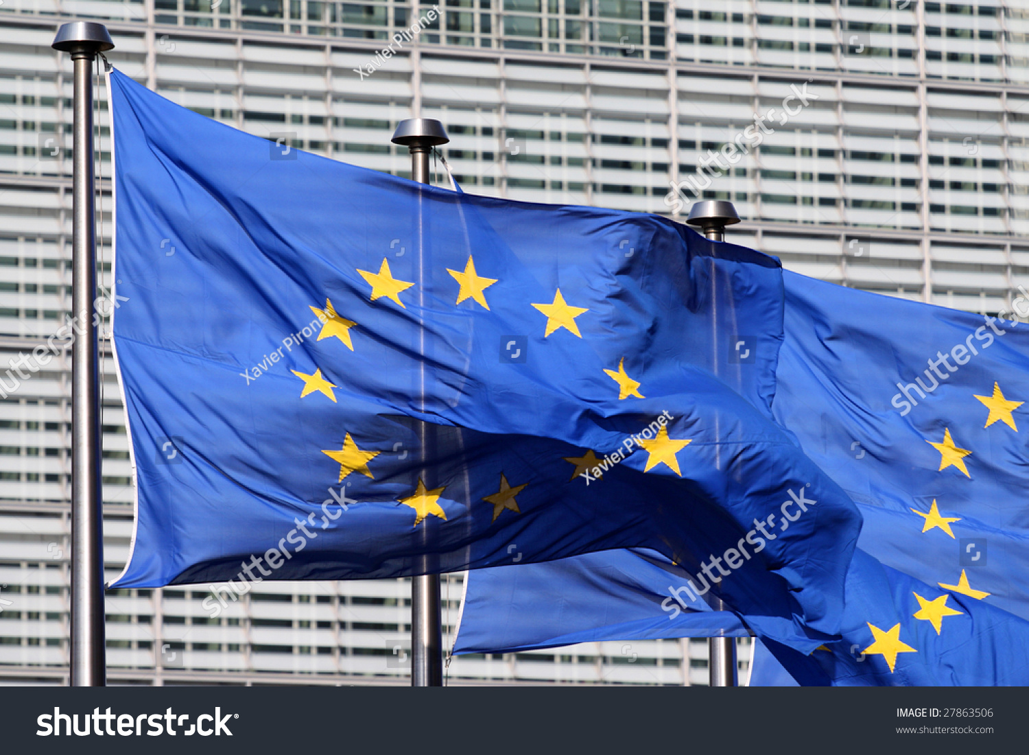 Wind Blowing On Building : European flags floating in front of the