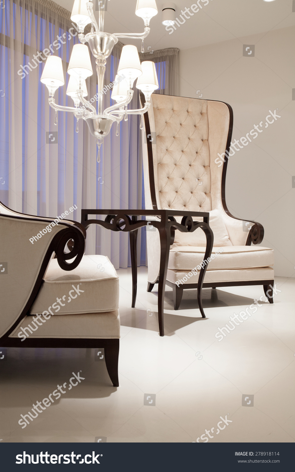 White Elegant Living Room With Two Vintage Style Armchairs