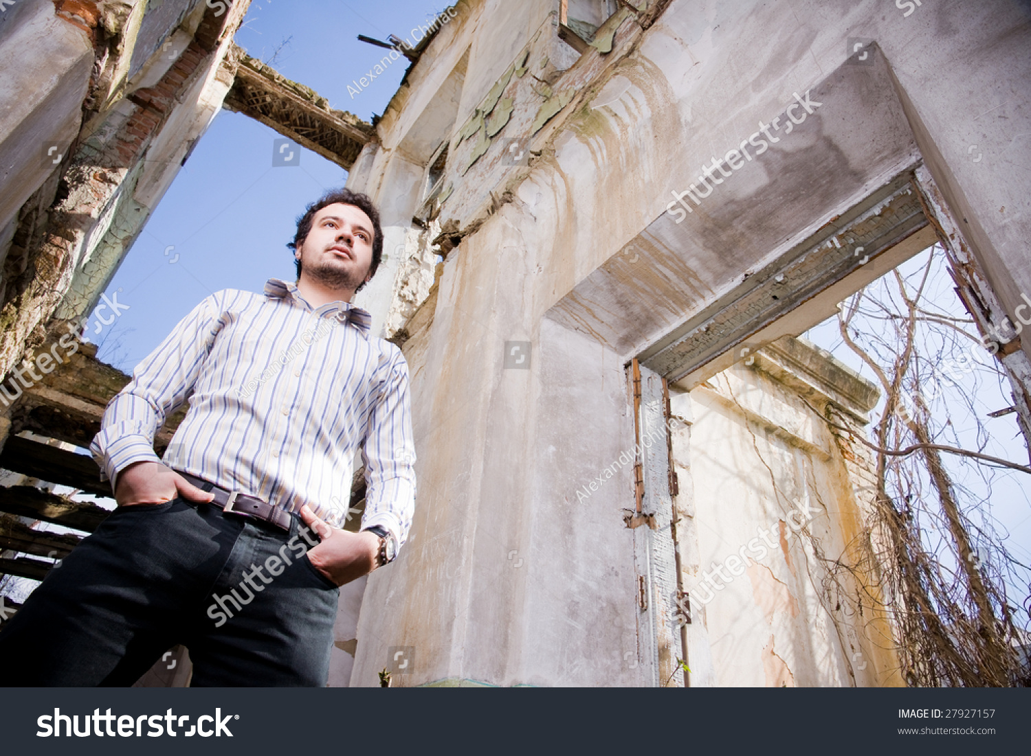 Young Man Abandoned Building Low Angle Stock Photo Edit Now 27927157