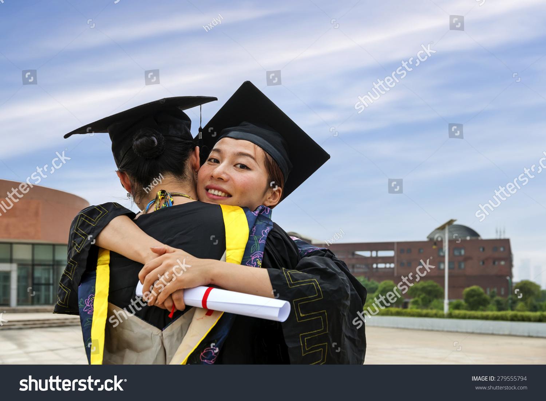 Beautiful Female Graduate Wearing Graduation Gown Stock Photo ...