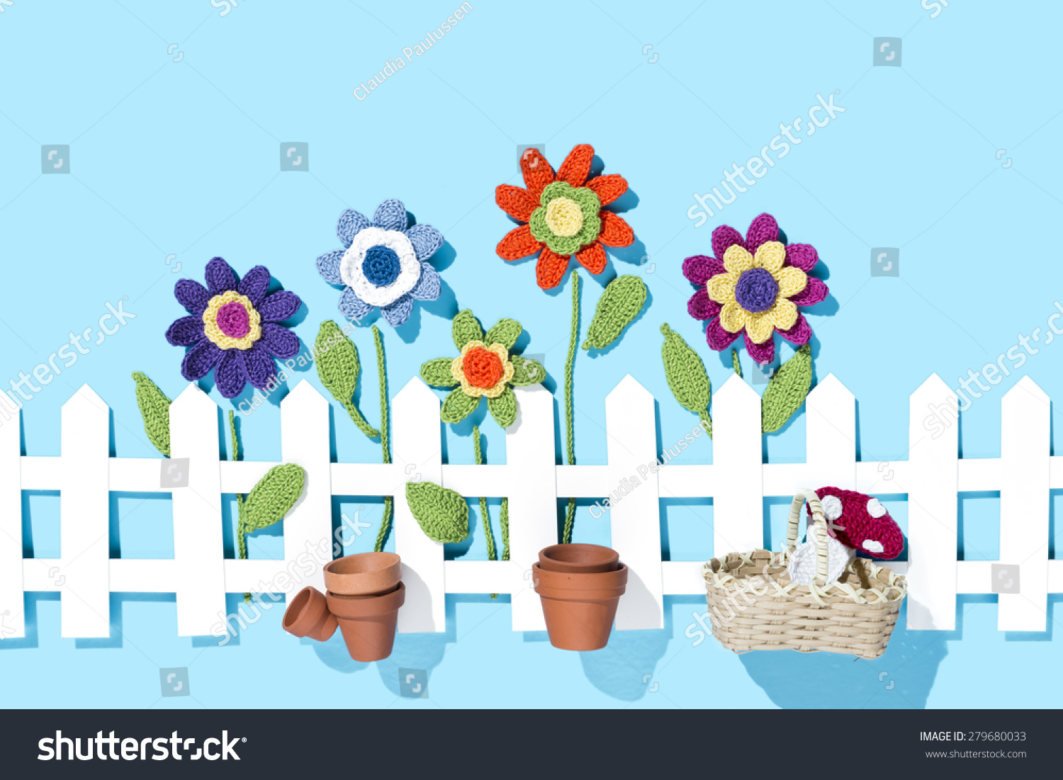 Crochet Flowers Behind White Paper Fence Stock Photo Edit Now