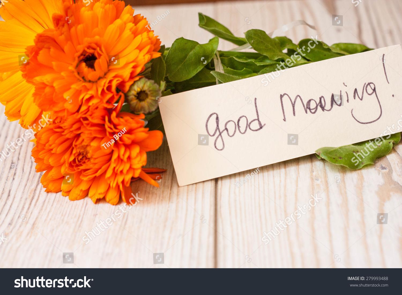 Good Morning Orange Flowers : Orange flowers with good morning note stock photo